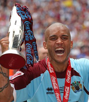 Clarke Carlisle after winning play-offs with Burnley to gain promotion into the Premier League